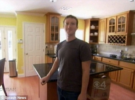 Mr Zuckerberg in the kitchen where he studies Chinese every morning