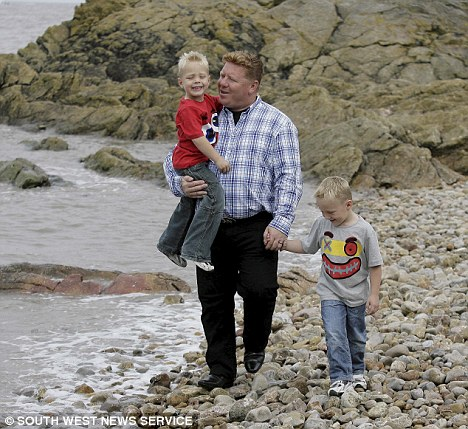 St John Greene with his sons Finn (left) and Reef on the beach in Clevedon - a favourite spot of their mother Kate