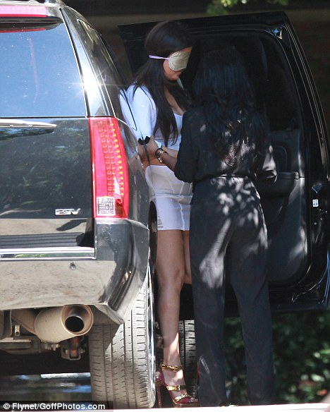 New photos show Khloe Kardashian in blindfold as she and