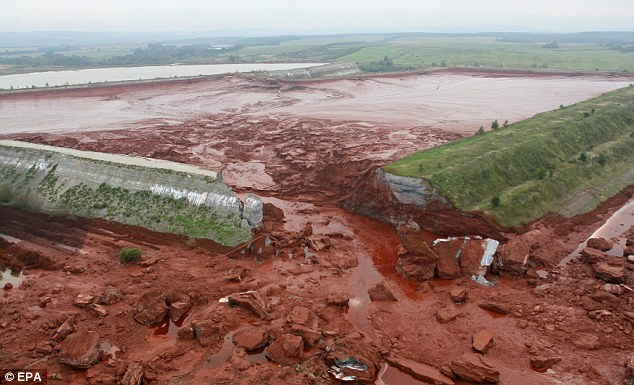 The source: The ruptured wall of the red sludge reservoir at the Ajkai Timfoldgyar plant in Kolontar