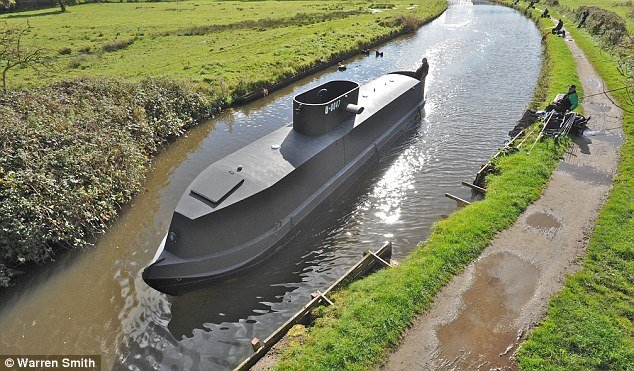 On the barge! The 70ft replica U-boat floats through the narrow waterways of the Leeds-Liverpool canal