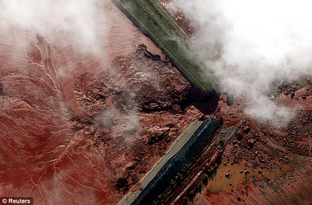 An aerial view of the broken dam that caused a toxic red sludge spill in western Hungary