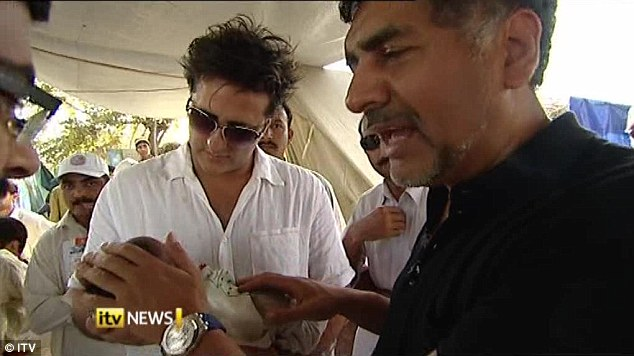 James Caan seen here in pakistan offering aid money in exchange for a child.