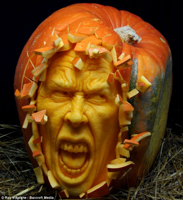 Horrifyingly good: Ray Villafane takes, on average, just two hours to carve one of his pumpkin sculptures, like this one entitled Shattered