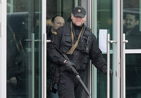 Dozens of armed men surrounded the Moscow bank building controlled by the Russian tycoon who owns Britain's Independent and Evening Standard newspapers