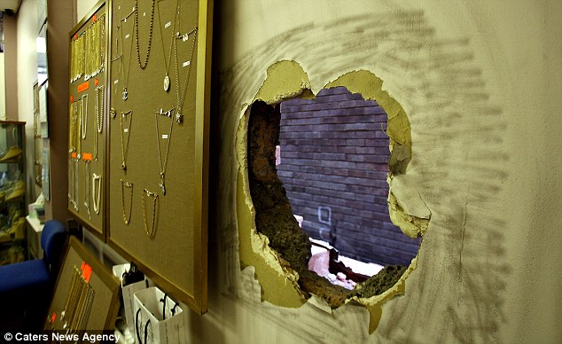 The hole seen from inside the jewellery shop showing necklaces that were not on the thief's agenda