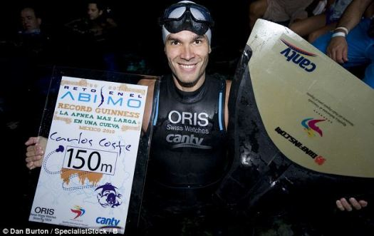 Success: Carlos Coste proudly poses after his death-defying world record attempt in the underwater caves just off Mexico