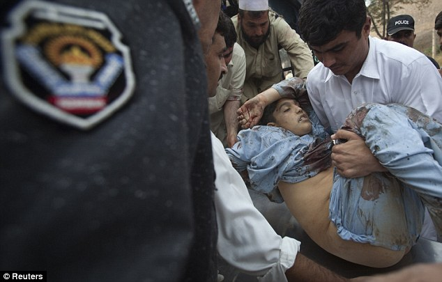 Stricken: Authorities said at least two children were among the dead in the attack which took place just after prayers