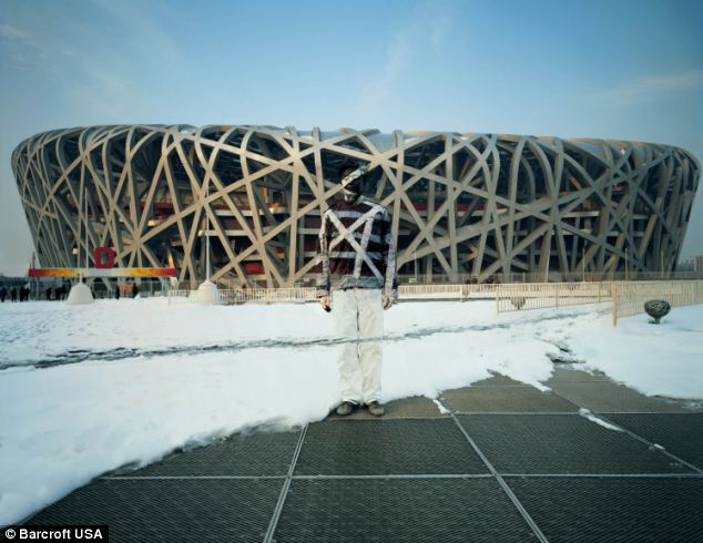 Where is Liu Bolin? the artist stands in front of the 'Birds Nest' Olympic Stadium in Beijing, China