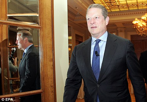 U-turn: Al Gore arrives at the conference hall before delivering his speech in Athens, Greece yesterday