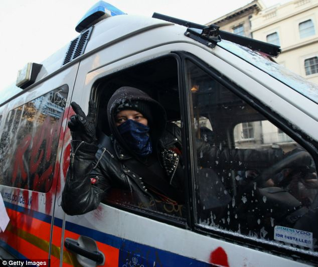 Pursuit: A female protester sits at the wheel of a police van during the protests