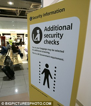 A sign warns of the additional body scanner at Heathrow