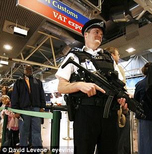 Armed police at Heathrow Terminal 4