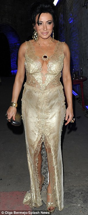 Nancy DellOlio is racy and lacy in a very revealing dress