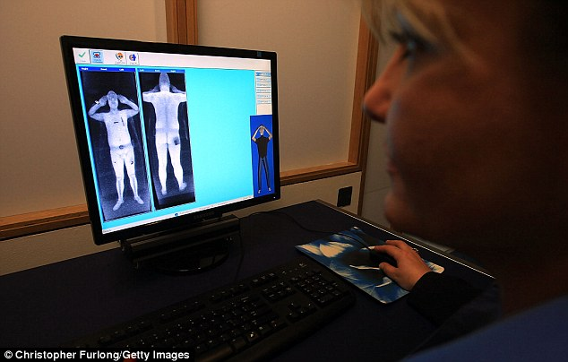 Security staff at Manchester Airport monitor body-scanner images