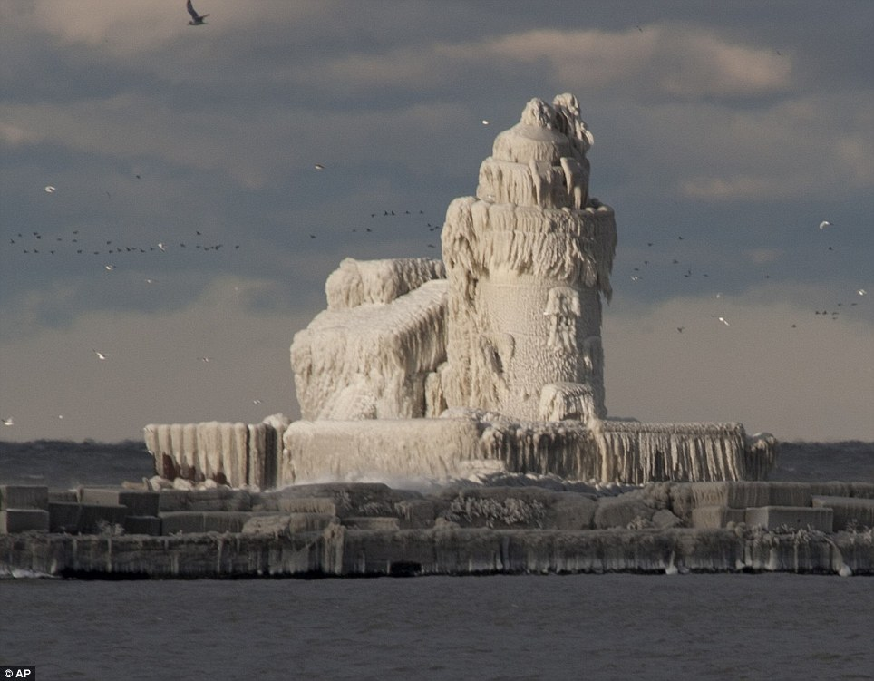 Spectacular: A small break in the cloud lights up the ice encrusted lighthouse at Cleveland Harbour, on Lake Erie, Ohio