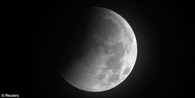 Pacman-like: A wedge of the moon is obscured by shadow in this image taken from Great Falls, Virginia. If conditions are right, the surface of the moon could glow blood red later this morning