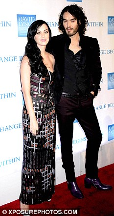 Happy couple: Katy and her husband on the red carpet earlier this month