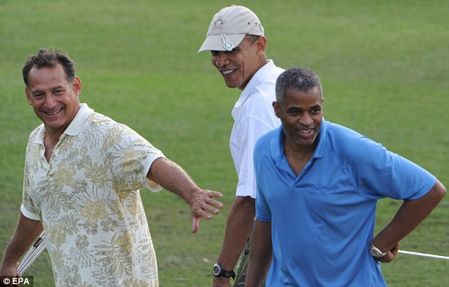 Friends: Mr Obama spend eight years at school in Hawaii and looked happy playing golf with old friends Bobby Titcomb (left) and Marty Nesbitt (right)