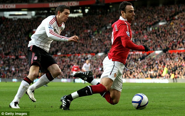 Fall guy: Dimitar Berbatov was awarded a penalty after the striker tumbled inside the area, despite what appeared to be minimal contact from Liverpool defender Daniel Agger