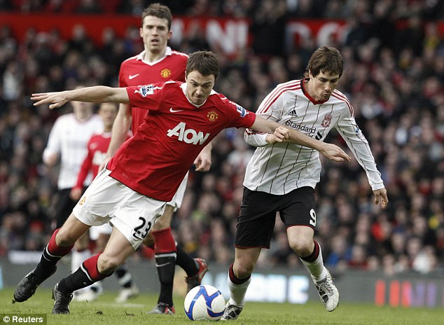 Another bad day at the office: Fernando Torres yet again failed to produce his best, easily dealt with by United defender Jonny Evans