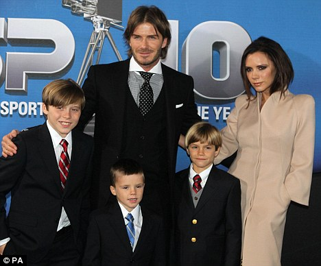 David and Victoria Beckham with sons Brooklyn, Cruz and Rome