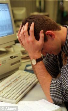 Depressed teacher at computer