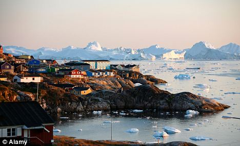 Low horizon: The fishing town of Ilulissat is Greenland's most westerly habitation. Temperatures in Greenland have risen 3C above average over the last year