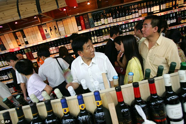 Emerging market: A busy shop in Beijing showing how demands for wine is booming among its middle classes