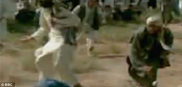Brutal: Men hurl chunks of rock, some bigger than a fist, during the execution