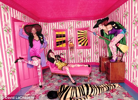 Familiar: Other images allegedly copied in the Rihanna video include a striped room with girls wearing red afro wigs dancing on the furniture