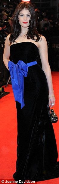 Lady in black: Gemma Arterton looked stunning in a flowing black velvet dress with a royal blue bow