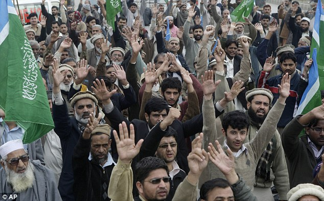 Frontline of terror: Jamaat e Islami supporters during another protest against Davis on Sunday