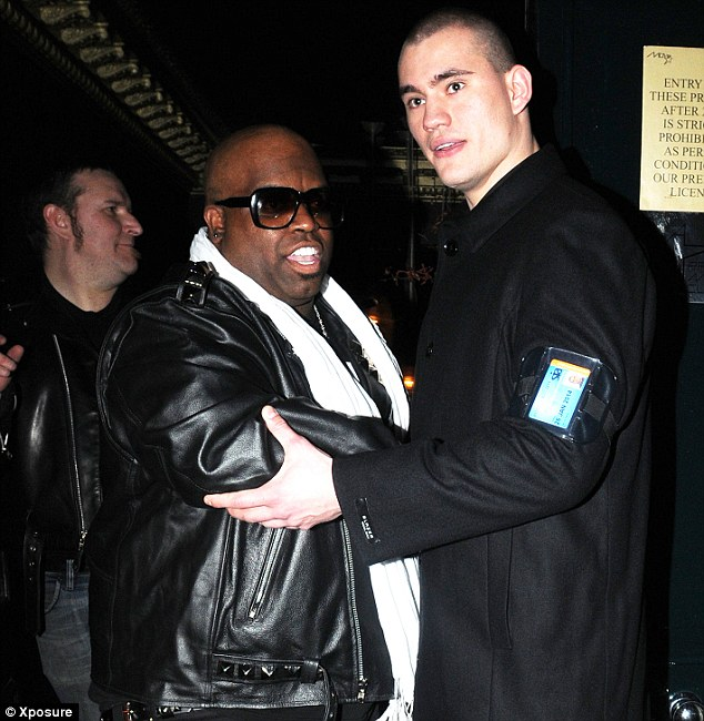 Out on his own: There weren't any other stars at the Movida Brit aftershow party, so Best International Solo Male winner Cee Lo Green celebrated with a security guard