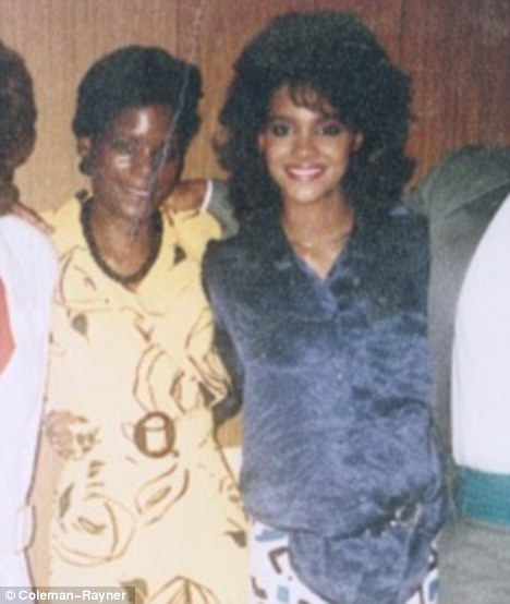 Before the fallout: Halle Berry, right, pictured in an old family photograph with her now-estranged sister Renee