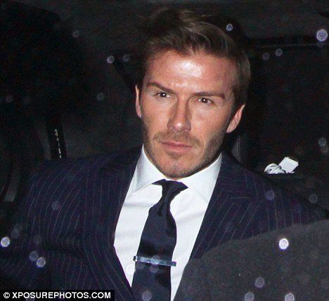 Suits you sir: David Beckham looked dapper as he arrived at the party, thrown by LOVE magazine, Alexander Wang and Liberty