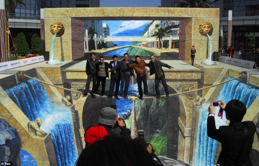 Don't look down: Chinese street artist Qi Xinghua's huge 3D painting, which is called 'Lions Gate Gorge', has set a new Guinness World Record