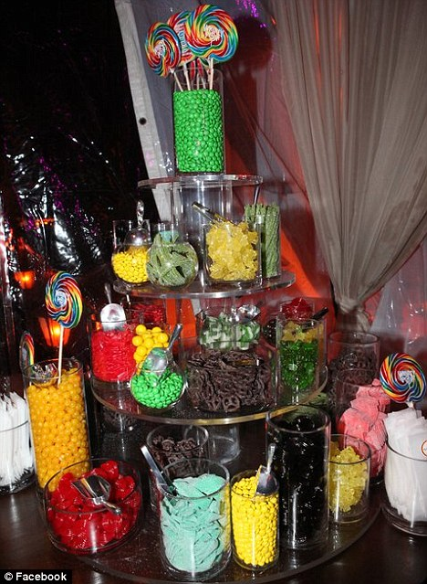 Sweet treat: The party guests had a selection of candy from a stand full of brightly coloured delectables