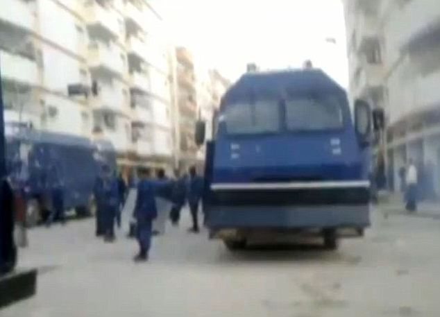 A British-made armored vehicle is seen here passing Libyan demonstrators in the capital city of Tripoli.