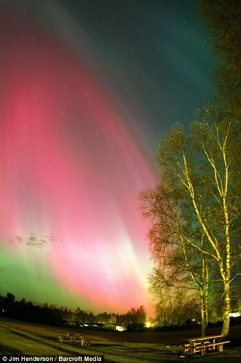 November 20, 2003: Auroras are caused by charged particles being blasted through space from the sun