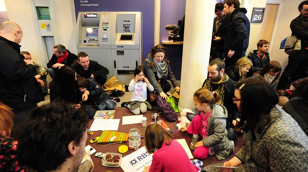 Playcentre: In Camden, north London, demonstrators invaded a NatWest and set up a creche where children played, practiced musical instruments while parents caught up