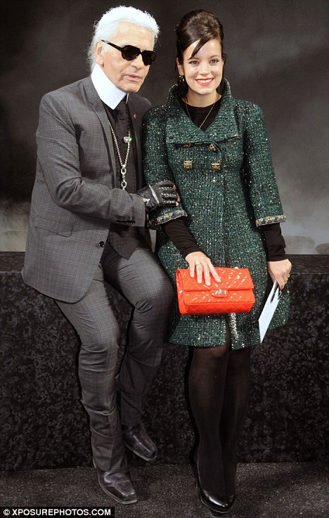 Smiling again: Lily Allen poses up with Chanel designer Karl Lagerfeld at his Autumn/Winter 2011 show in Paris, after revealing he will create her wedding dress