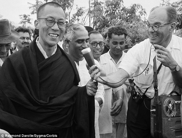 Fleeing his country: the Dalai Lama is interviewed as he arrives in India, where he will spend the rest of his life in exile