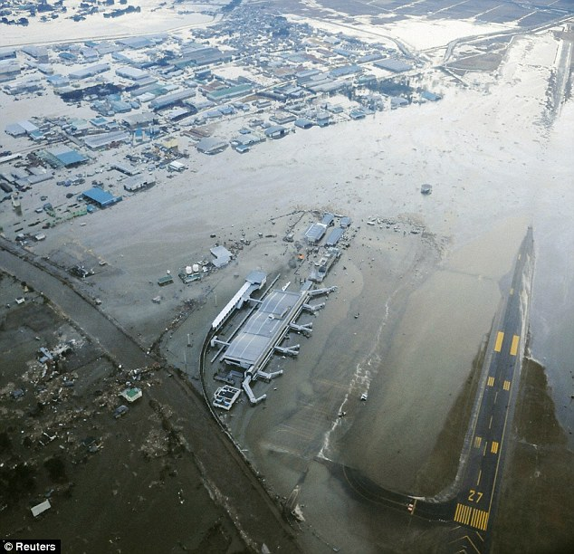 Closed: Sendai Airport in north-east Japan was one of the first places to be swamped by the tsunami that raced inland following the quake