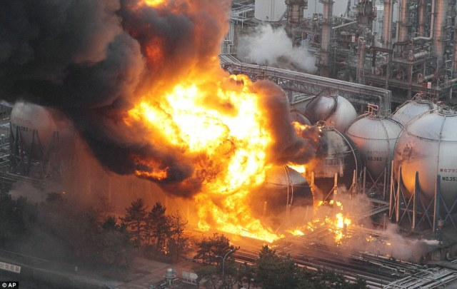 Explosions: Giant fireballs rise from a burning oil refinery in Ichihara, Chiba Prefecture after being shaken by the earthquake off the coast