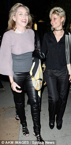 Favourites: Sharon wore a similar pair of leather trousers in black to nightclub Voyeur just a few days ago