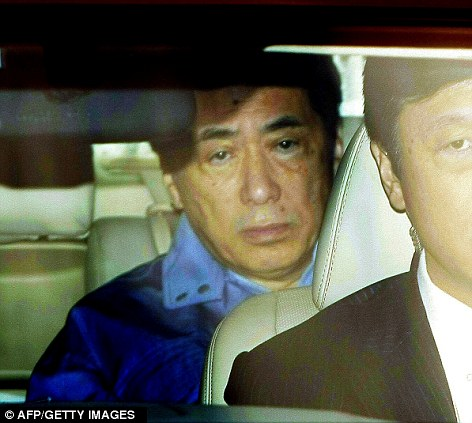 Crisis meeting: Japanese Prime Minister Naoto Kan leaves the headquarters of the Tokyo Electric Power Co, operators of the Fukushima plant, in Tokyo today