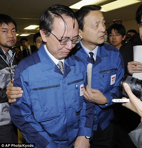 Overwhelmed: Tokyo Electric Power Company Managing Director Akio Komiri cries as he leaves after a press conference in Fukushima