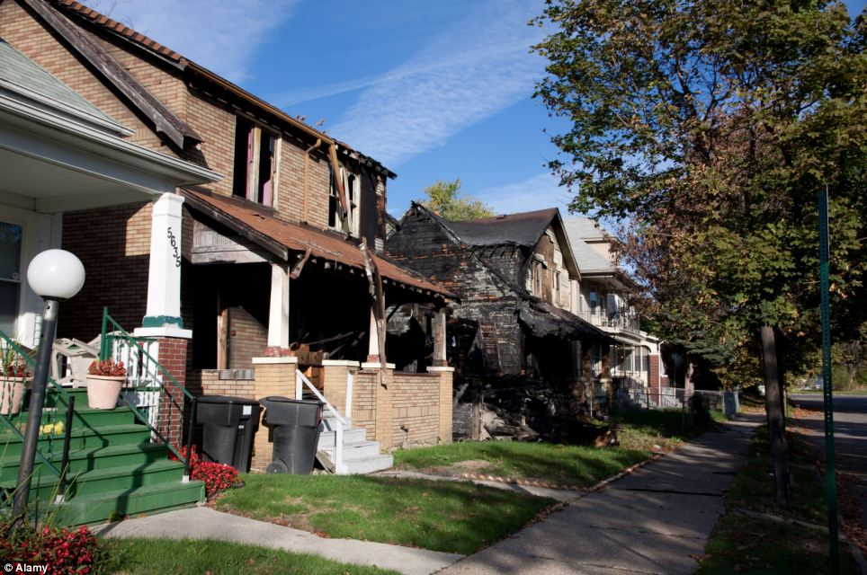 Empty: Burned-out vacant dwellings in Detroit, Michigan, which abound in the city, the population of which has dropped by 25 per cent in ten years