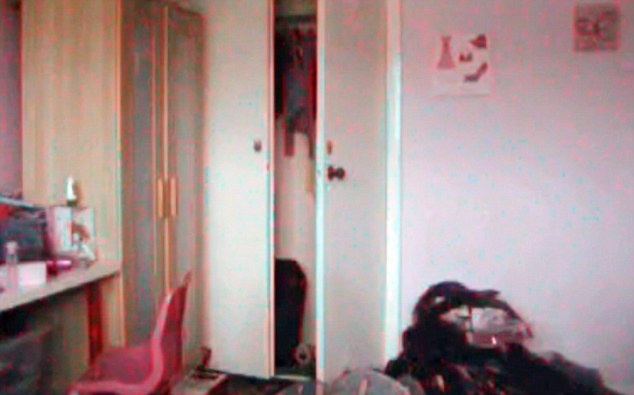 swivel chair king living black fabric dining chairs coventry family call in paranormal experts after 'capturing ghost' home video | daily mail online